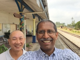 Kin Yong with me on the platform of the Tumpat Railway Station, happy to have found the place and my father's lighthouse nearby.