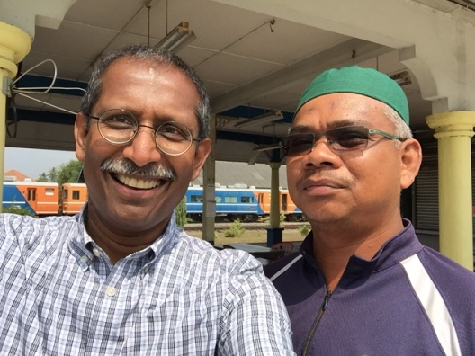 Tumpat station master Azman Hassan helped me find my father's lighthouse and the rest house where he posed for pictures.